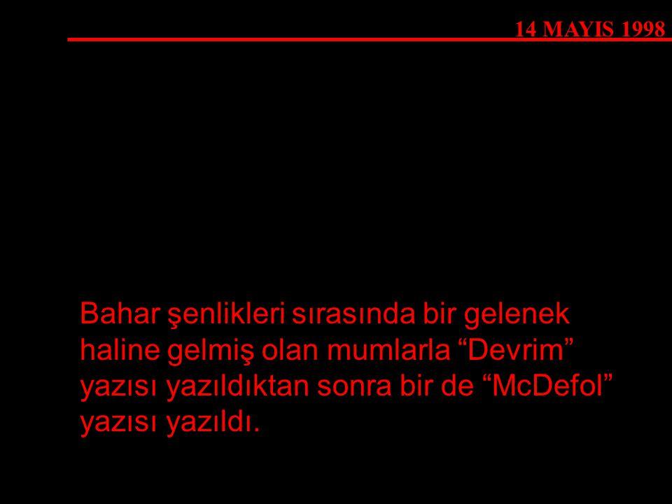 """14 MAYIS 1998 Bahar şenlikleri sırasında bir gelenek haline gelmiş olan mumlarla """"Devrim"""" yazısı yazıldıktan sonra bir de """"McDefol"""" yazısı yazıldı."""