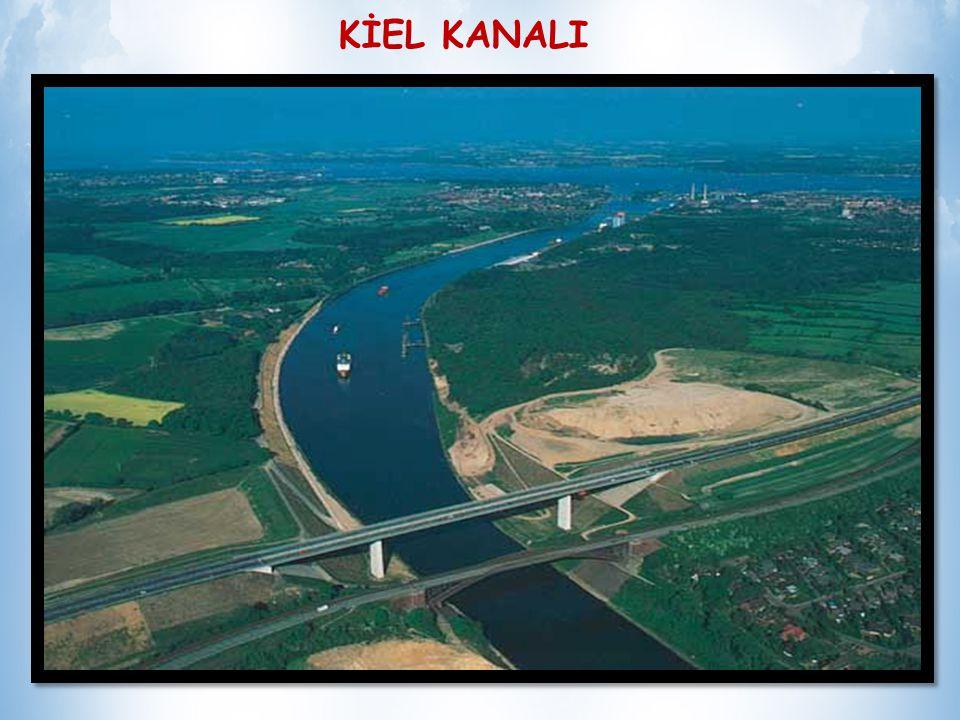 KİEL KANALI İki deniz arasındaki en güvenli, kısa ve ucuz ulaşım yoludur Kanal, 1887-95 arasında, kuzeye gidecek savaş gemilerine kestirme bir yol sağlamak amacıyla yapıldı.