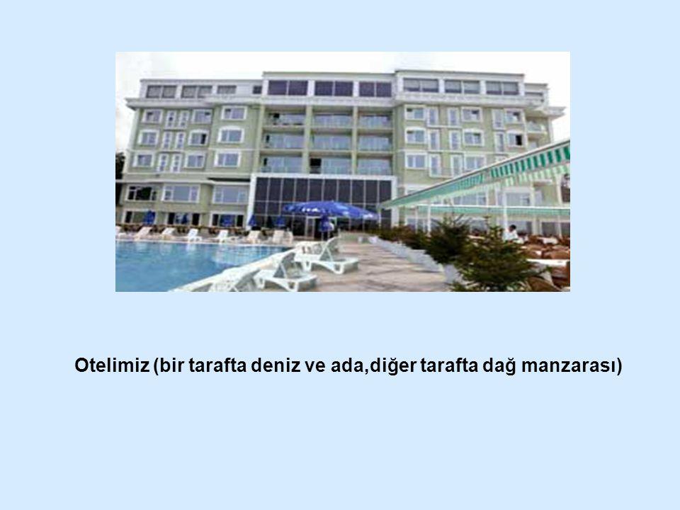 Otelimiz (bir tarafta deniz ve ada,diğer tarafta dağ manzarası)