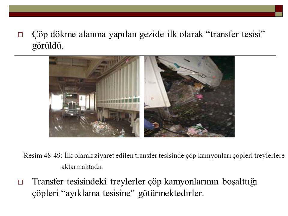 """ Çöp dökme alanına yapılan gezide ilk olarak """"transfer tesisi"""" görüldü.  Transfer tesisindeki treylerler çöp kamyonlarının boşalttığı çöpleri """"ayıkl"""