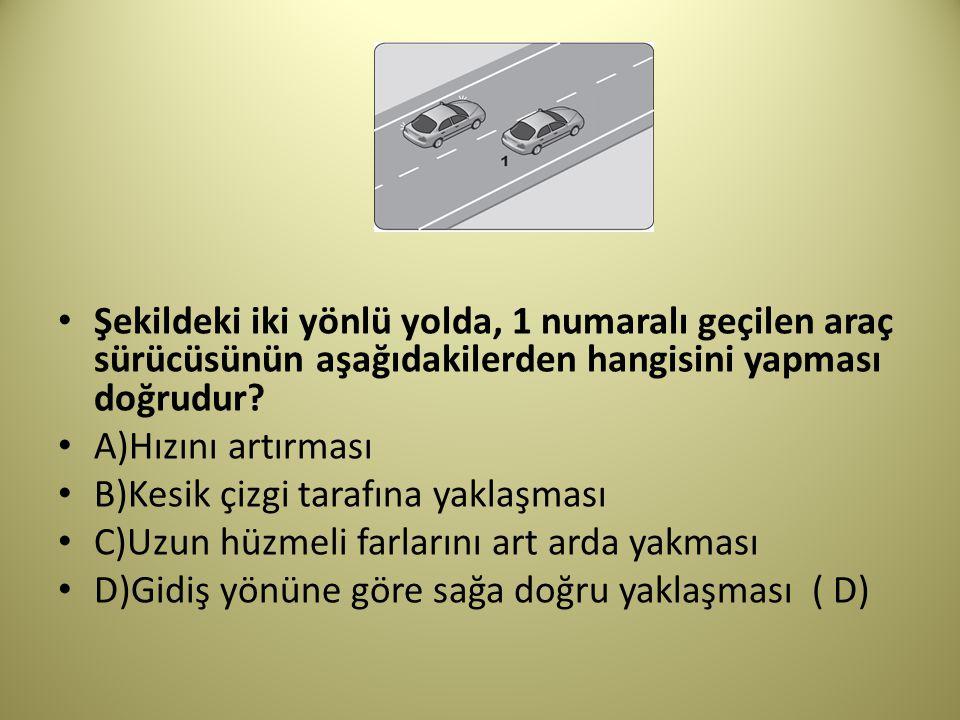 Şekildeki iki yönlü yolda, 1 numaralı geçilen araç sürücüsünün aşağıdakilerden hangisini yapması doğrudur.
