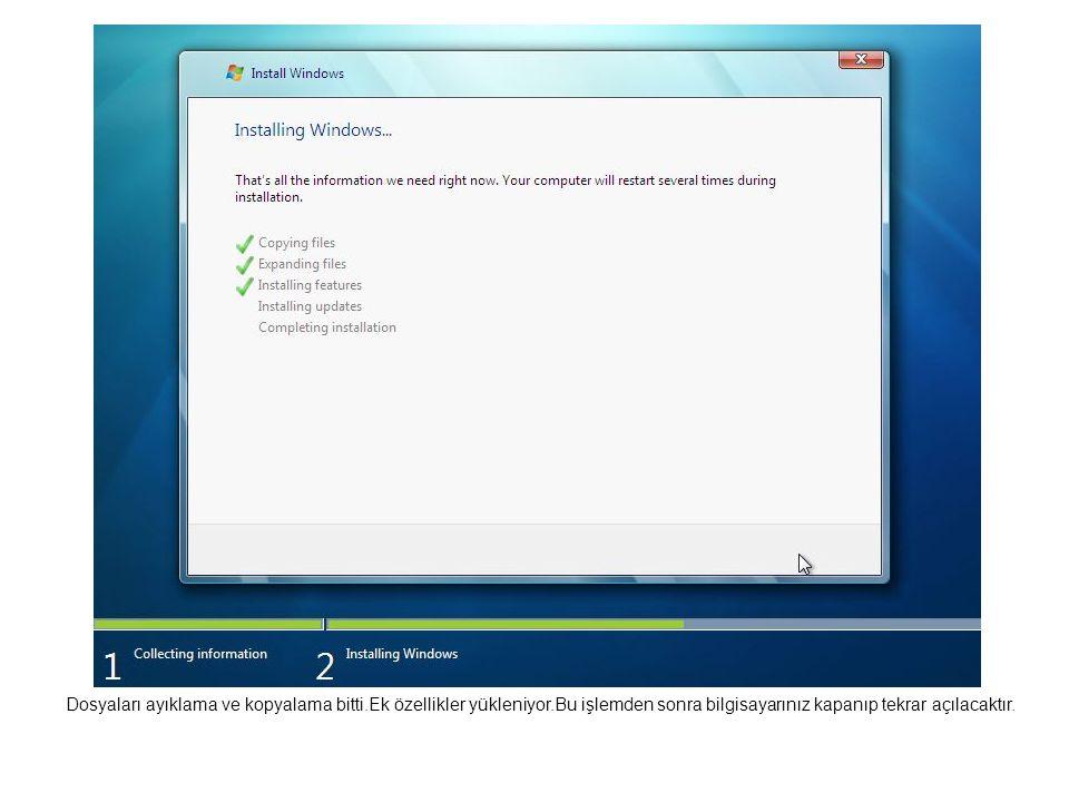 Dosyaları ayıklama ve kopyalama bitti.Ek özellikler yükleniyor.Bu işlemden sonra bilgisayarınız kapanıp tekrar açılacaktır.