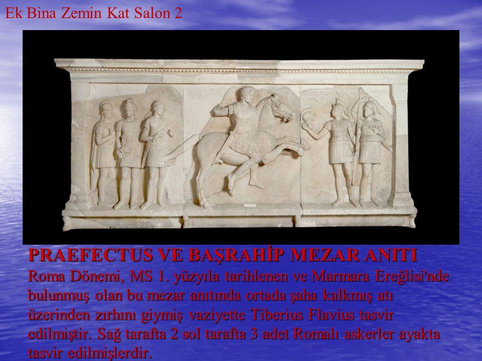 PRAEFECTUS VE BAŞRAHİP MEZAR ANITI Roma Dönemi, MS 1. yüzyıla tarihlenen ve Marmara Ereğlisi'nde bulunmuş olan bu mezar anıtında ortada şaha kalkmış a