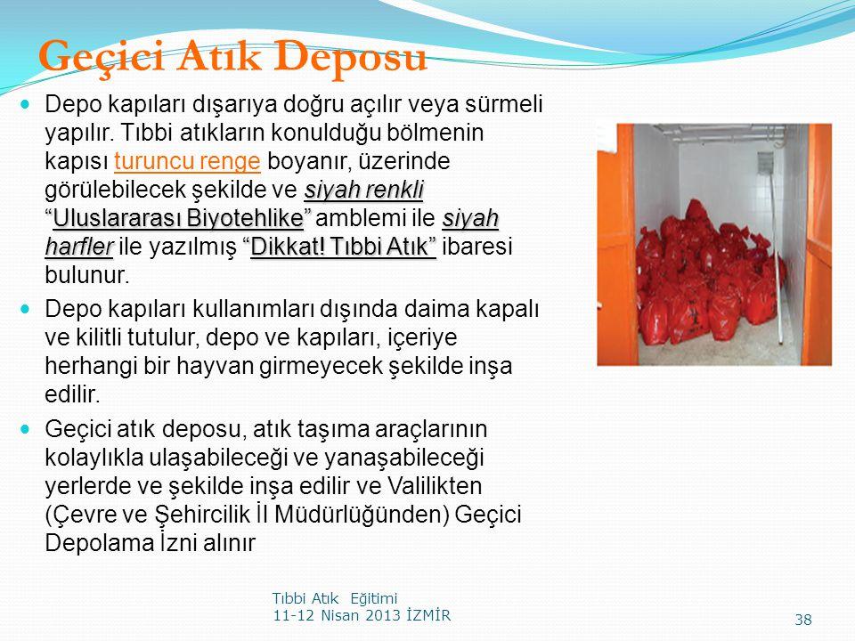 """Geçici Atık Deposu Tıbbi Atık Eğitimi 11-12 Nisan 2013 İZMİR 38 siyah renkli """"Uluslararası Biyotehlike""""siyah harfler""""Dikkat! Tıbbi Atık"""" Depo kapıları"""