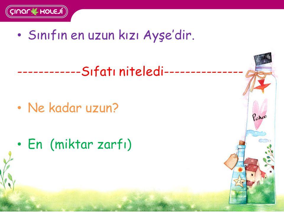 Sınıfın en uzun kızı Ayşe'dir. ------------Sıfatı niteledi--------------- Ne kadar uzun? En (miktar zarfı)