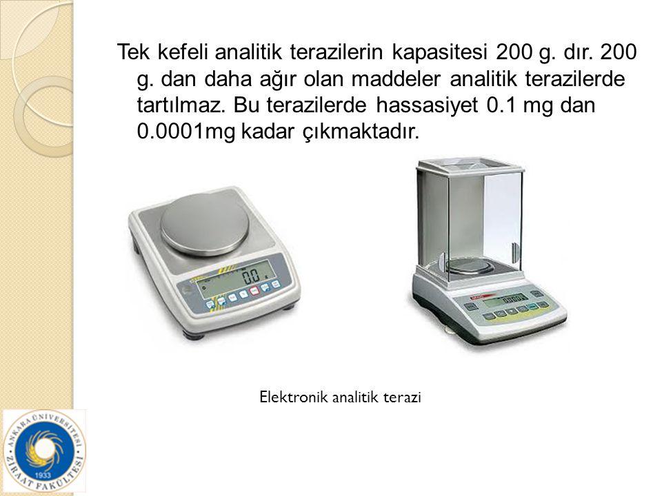 Tek kefeli analitik terazilerin kapasitesi 200 g. dır. 200 g. dan daha ağır olan maddeler analitik terazilerde tartılmaz. Bu terazilerde hassasiyet 0.