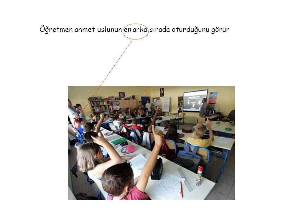 Öğretmen ahmet uslunun en arka sırada oturduğunu görür