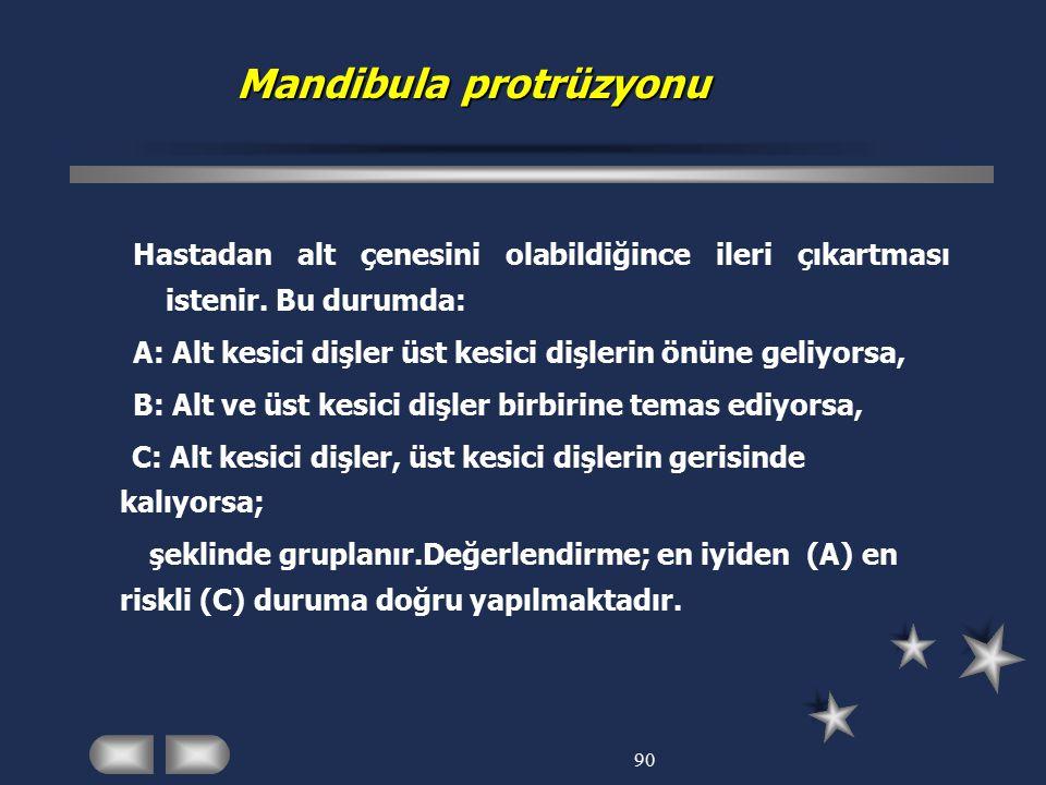 90 Mandibula protrüzyonu Mandibula protrüzyonu Hastadan alt çenesini olabildiğince ileri çıkartması istenir. Bu durumda: A: Alt kesici dişler üst kesi