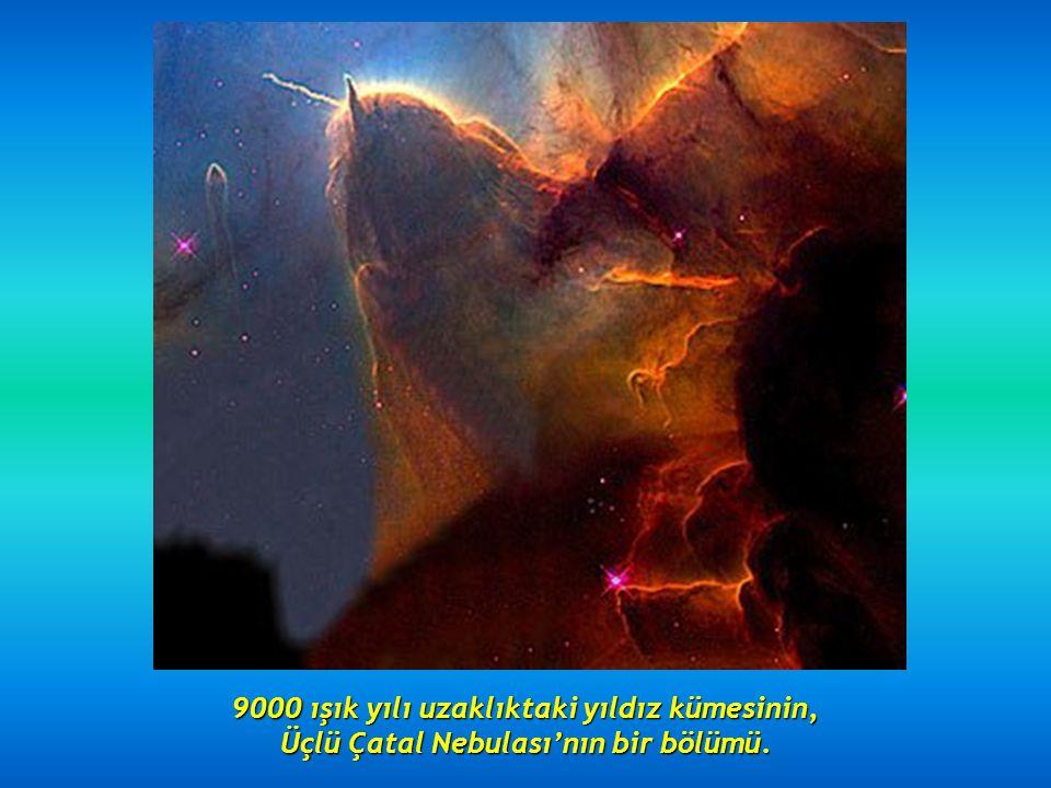Girdap gibi dönen iki galaksi : 114 milyon ışık yılı uzaktaki NGC 2207 ve IC 2163.