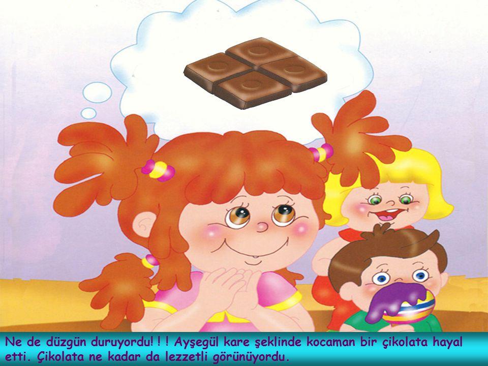Ne de düzgün duruyordu! ! ! Ayşegül kare şeklinde kocaman bir çikolata hayal etti. Çikolata ne kadar da lezzetli görünüyordu.
