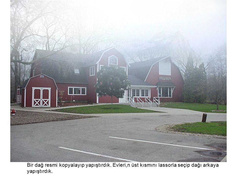 Bir dağ resmi kopyalayıp yapıştırdık. Evleri,n üst kısmını lassorla seçip dağı arkaya yapıştırdık.