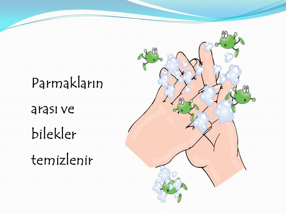 Parmakların arası ve bilekler temizlenir