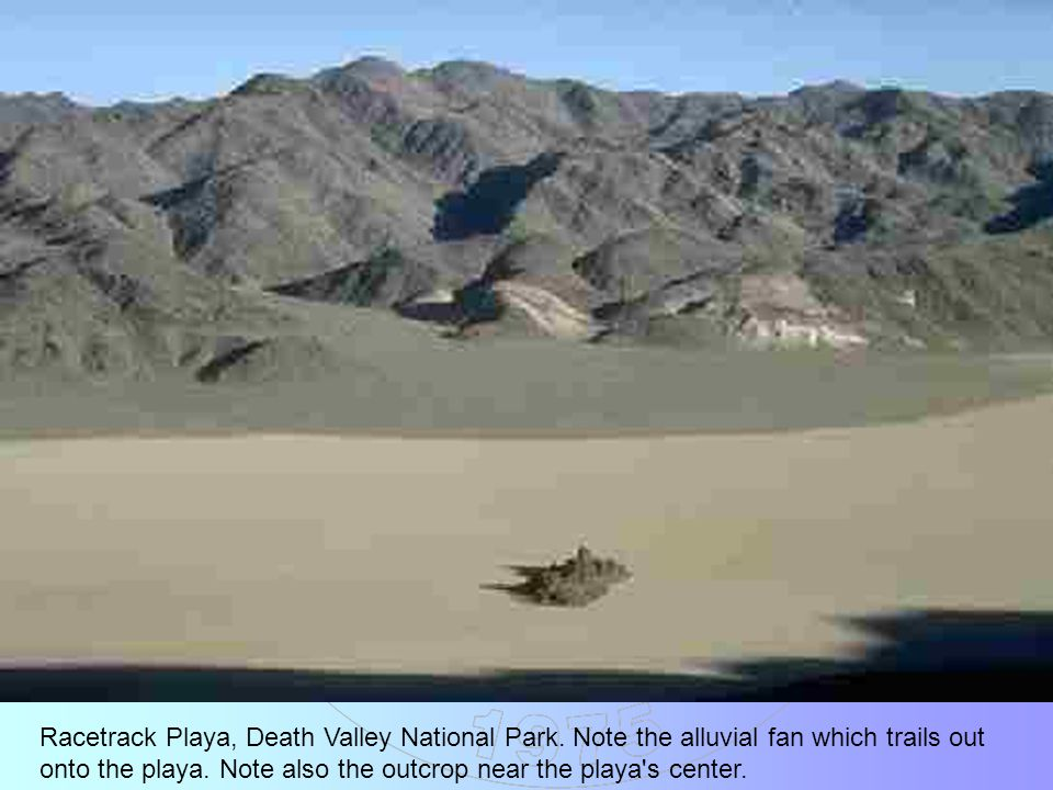 Racetrack Playa, Death Valley National Park. Note the alluvial fan which trails out onto the playa. Note also the outcrop near the playa's center.