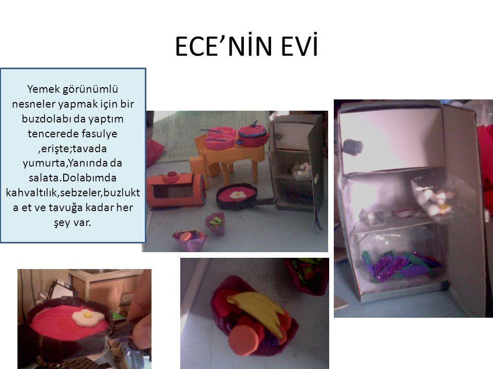 ECE'NİN EVİ Yemek görünümlü nesneler yapmak için bir buzdolabı da yaptım tencerede fasulye,erişte;tavada yumurta,Yanında da salata.Dolabımda kahvaltıl