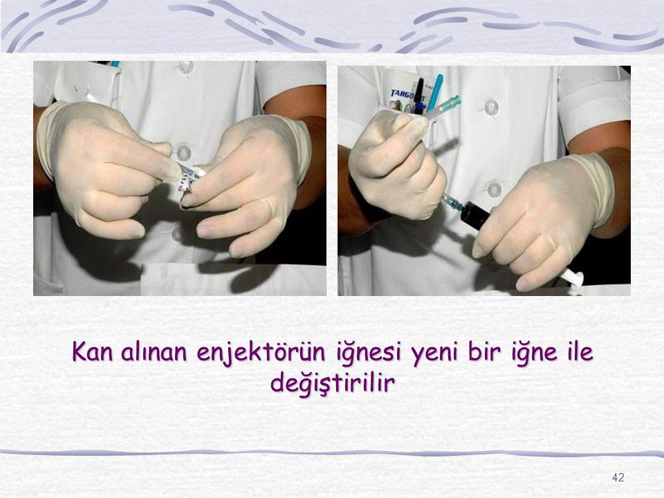 42 Kan alınan enjektörün iğnesi yeni bir iğne ile değiştirilir