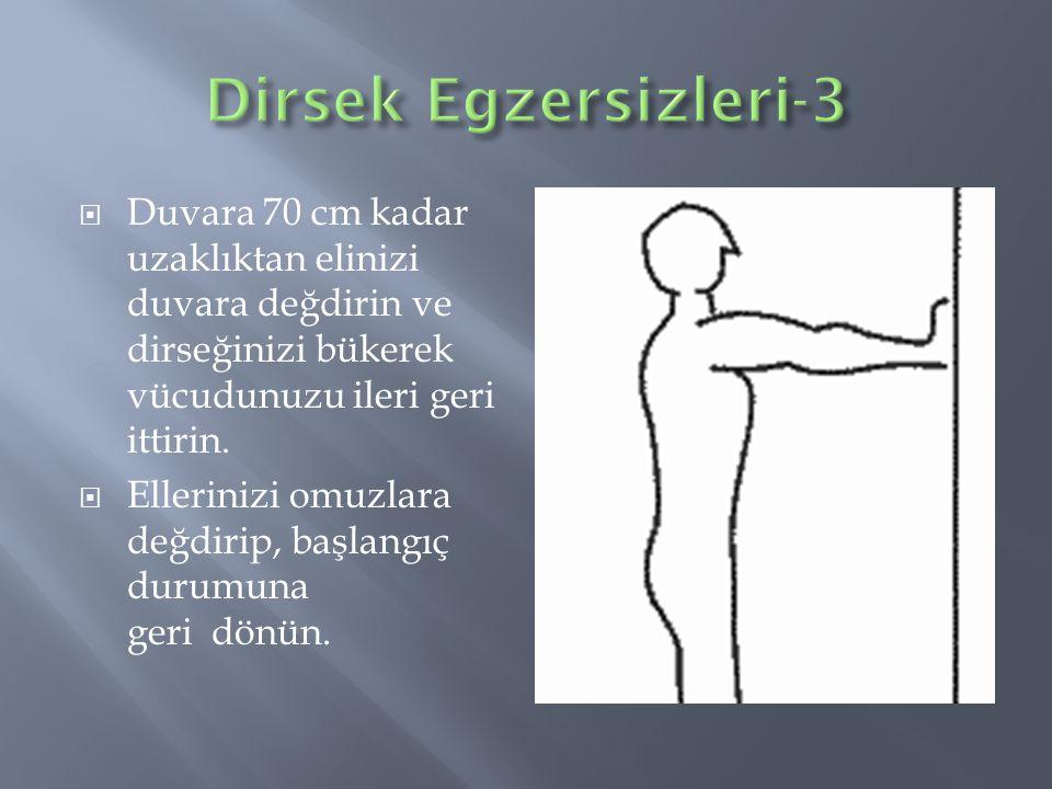  Duvara 70 cm kadar uzaklıktan elinizi duvara değdirin ve dirseğinizi bükerek vücudunuzu ileri geri ittirin.  Ellerinizi omuzlara değdirip, başlangı