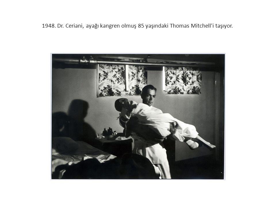 1948. Dr. Ceriani, ayağı kangren olmuş 85 yaşındaki Thomas Mitchell'i taşıyor.