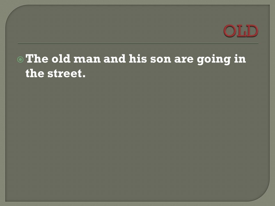  The old man and his son are going in the street.