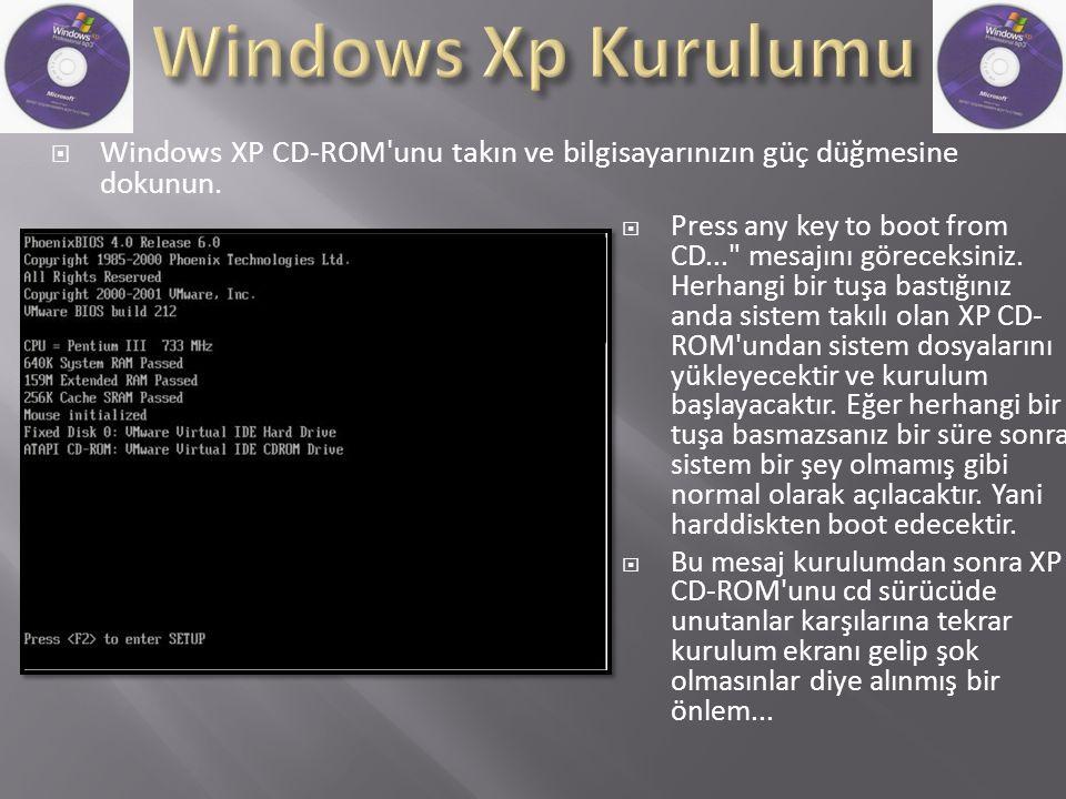  Windows XP CD-ROM unu takın ve bilgisayarınızın güç düğmesine dokunun.