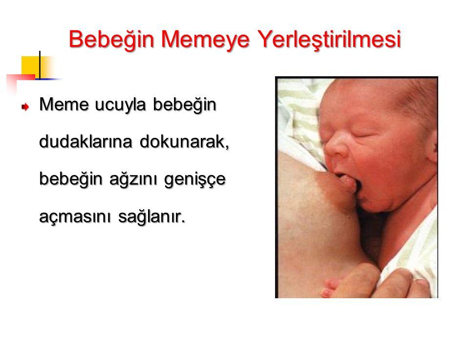 Bebeğin Memeye Yerleştirilmesi Meme ucuyla bebeğin dudaklarına dokunarak, bebeğin ağzını genişçe açmasını sağlanır.