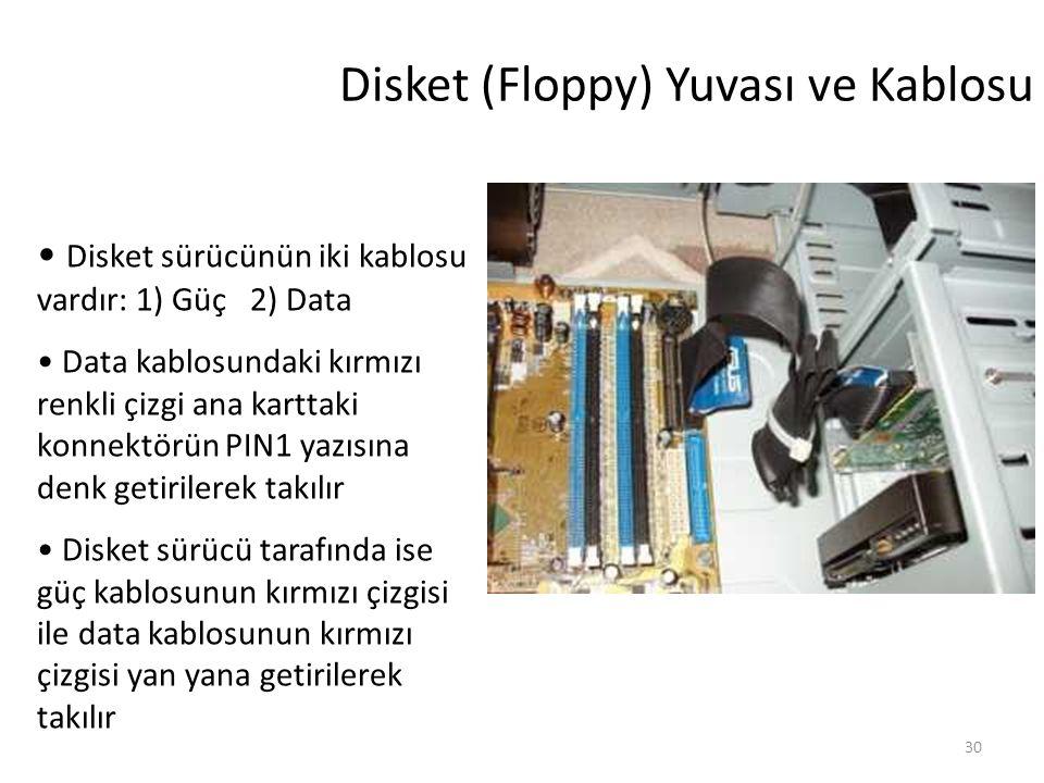 30 Disket (Floppy) Yuvası ve Kablosu Disket sürücünün iki kablosu vardır: 1) Güç 2) Data Data kablosundaki kırmızı renkli çizgi ana karttaki konnektörün PIN1 yazısına denk getirilerek takılır Disket sürücü tarafında ise güç kablosunun kırmızı çizgisi ile data kablosunun kırmızı çizgisi yan yana getirilerek takılır