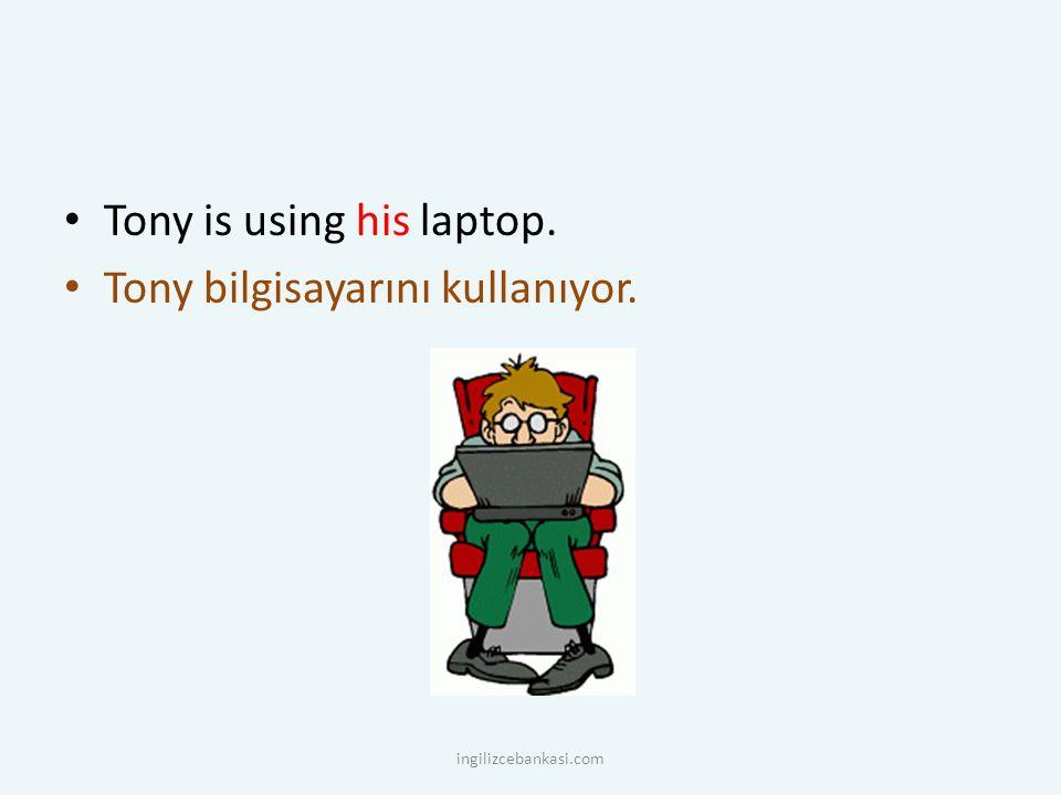 Tony is using his laptop. Tony bilgisayarını kullanıyor. ingilizcebankasi.com