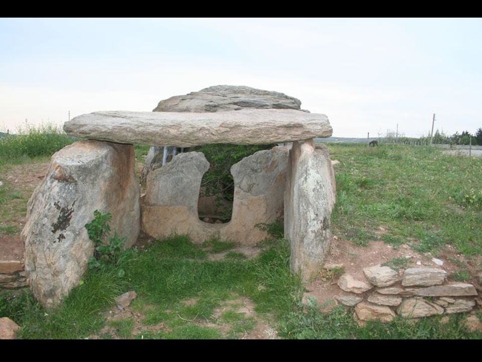 A dolmen (also known as cromlech (Welsh), anta, Hünengrab, Hunebed, Goindol, quoit, and portal dolmen) is a type of single-chamber megalithic tomb, usually consisting of three or more upright stones supporting a large flat horizontal capstone (table).