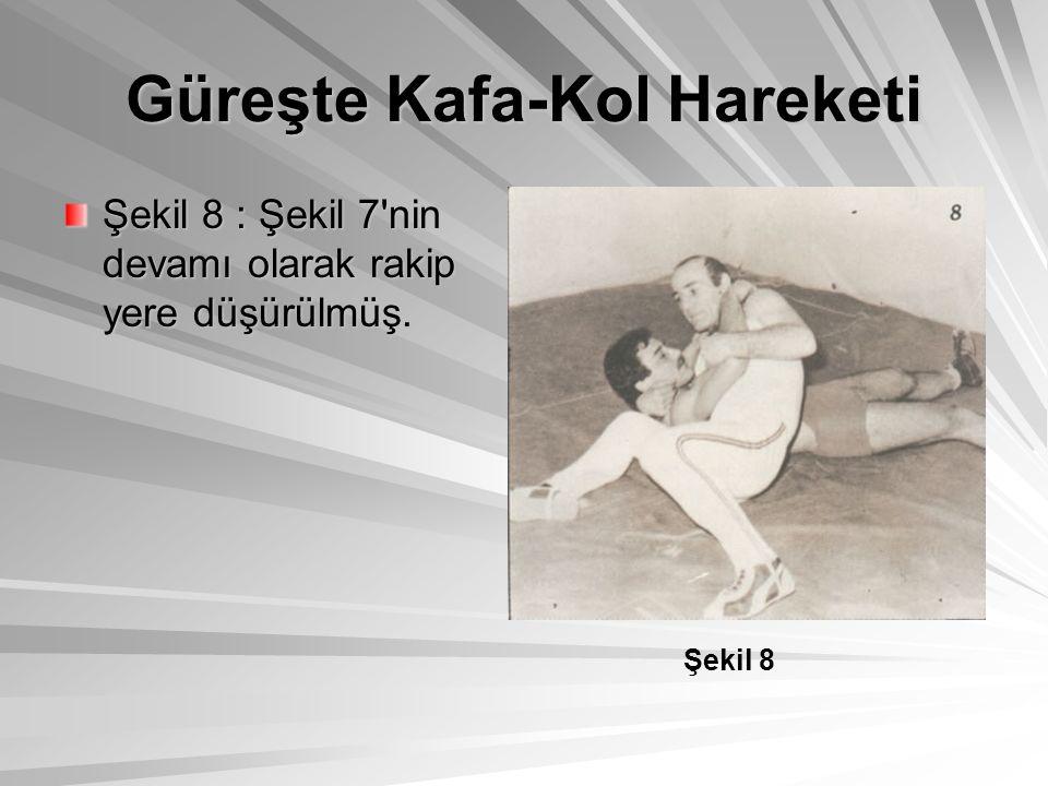 Şekil 9 : Rakip yere düşürülmüş ve yerde rakibin kaçmaması için kafa kendine doğru çekilmiş hareketi yapan ayaklarını açarak rakibini kontrol altına almış.