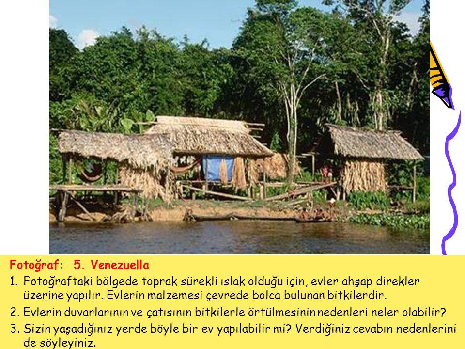 Fotoğraf: 5. Venezuella 1.Fotoğraftaki bölgede toprak sürekli ıslak olduğu için, evler ahşap direkler üzerine yapılır. Evlerin malzemesi çevrede bolca