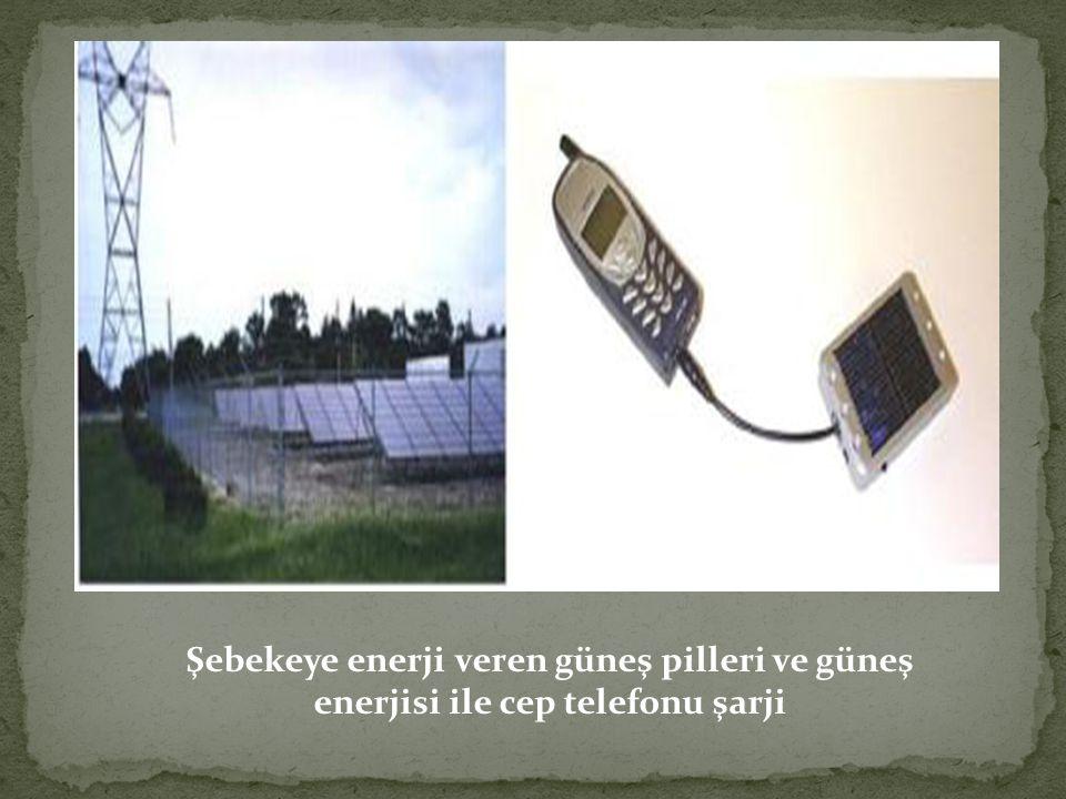 Şebekeye enerji veren güneş pilleri ve güneş enerjisi ile cep telefonu şarji