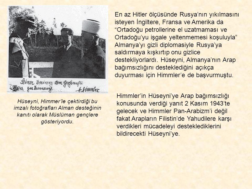 """Hüseyni Himmler'le tokalaşırken. Bu görüşmede Hitler,Hüseyni'yi """"Araplarla ilgili konularda karar verecek kişi ve Arapların önderi"""" olarak tanıdığını"""