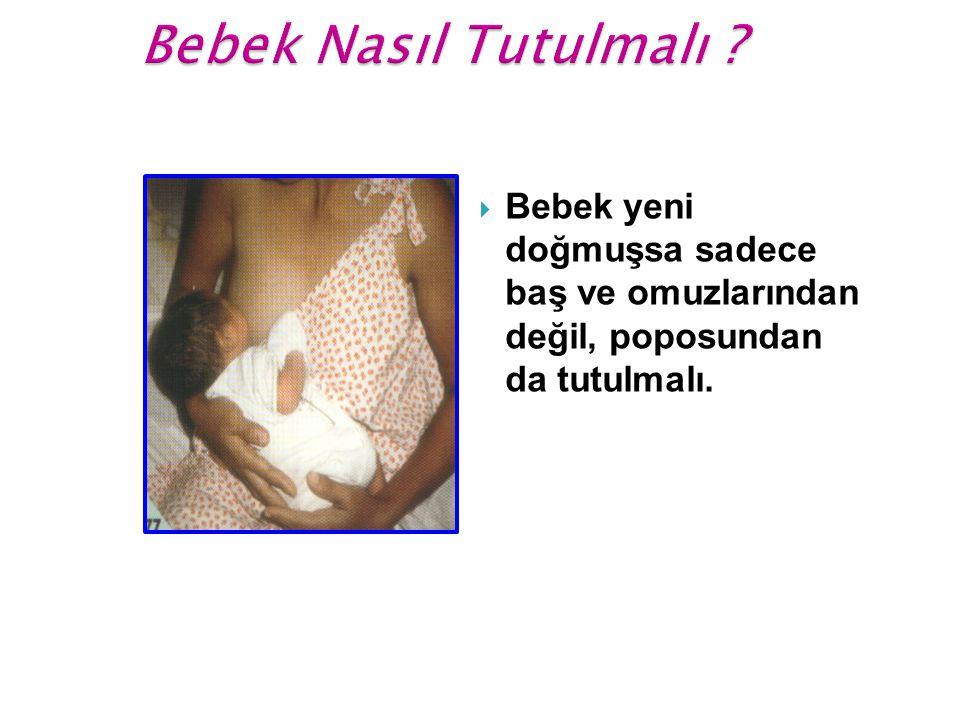  Bebek yeni doğmuşsa sadece baş ve omuzlarından değil, poposundan da tutulmalı.