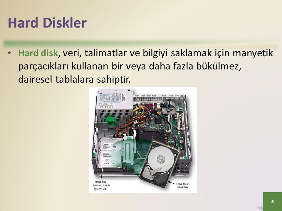 Hard Diskler • Hard disk, veri, talimatlar ve bilgiyi saklamak için manyetik parçacıkları kullanan bir veya daha fazla bükülmez, dairesel tablalara sa