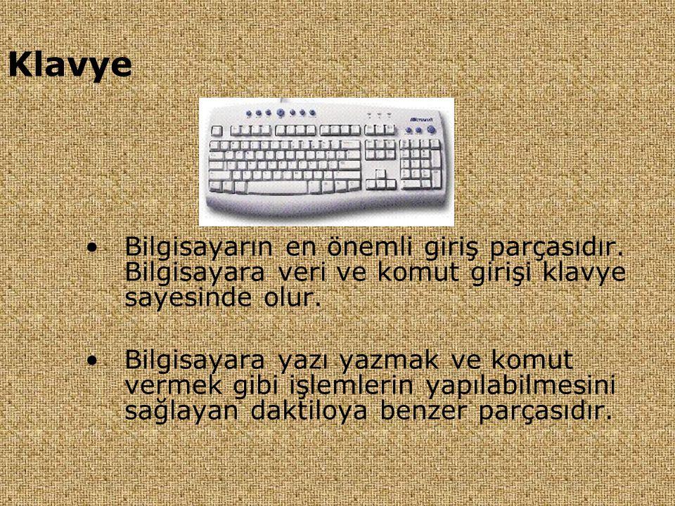 Klavye •Bilgisayarın en önemli giriş parçasıdır. Bilgisayara veri ve komut girişi klavye sayesinde olur. •Bilgisayara yazı yazmak ve komut vermek gibi