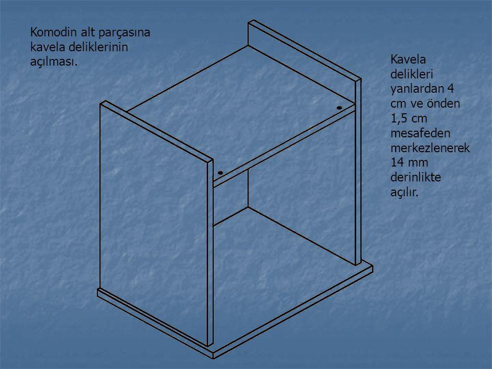Komodin alt parçasına kavela deliklerinin açılması. Kavela delikleri yanlardan 4 cm ve önden 1,5 cm mesafeden merkezlenerek 14 mm derinlikte açılır.