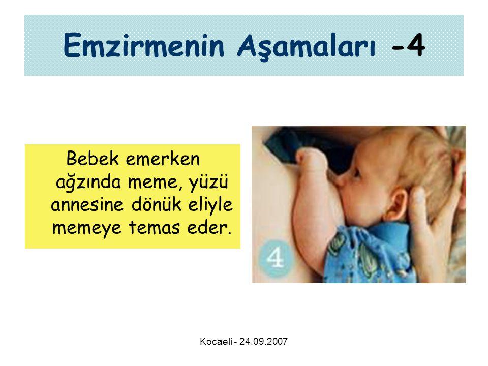 Kocaeli - 24.09.2007 Emzirmenin Aşamaları -4 Bebek emerken ağzında meme, yüzü annesine dönük eliyle memeye temas eder.
