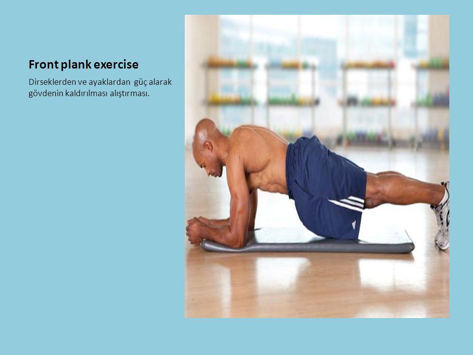 Front plank exercise Dirseklerden ve ayaklardan güç alarak gövdenin kaldırılması alıştırması.
