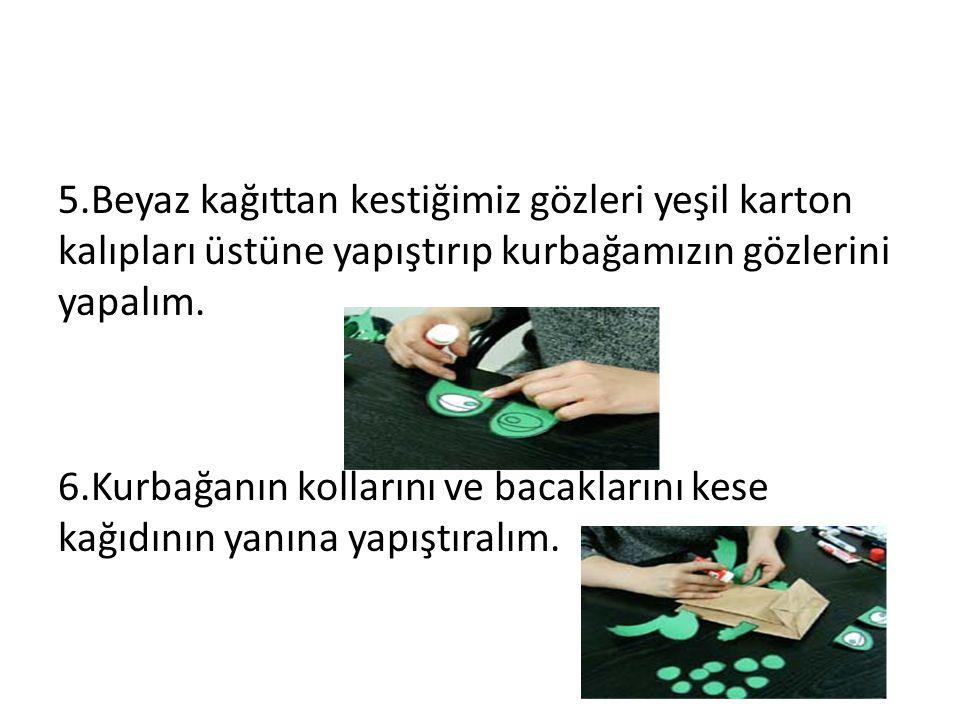 5.Beyaz kağıttan kestiğimiz gözleri yeşil karton kalıpları üstüne yapıştırıp kurbağamızın gözlerini yapalım. 6.Kurbağanın kollarını ve bacaklarını kes