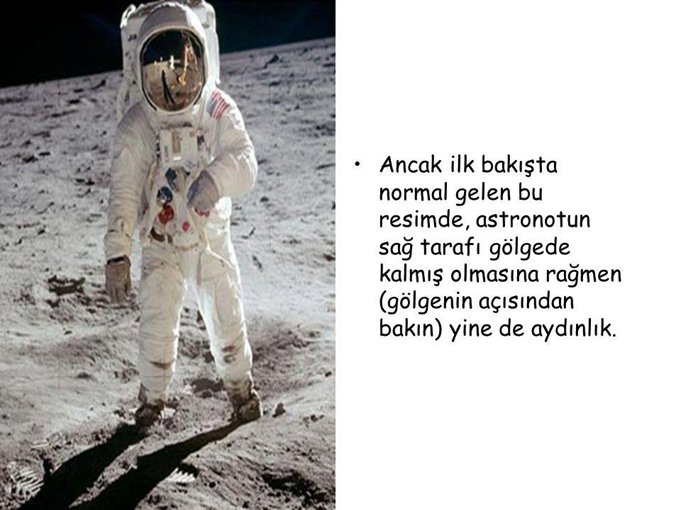 •Ancak ilk bakışta normal gelen bu resimde, astronotun sağ tarafı gölgede kalmış olmasına rağmen (gölgenin açısından bakın) yine de aydınlık.