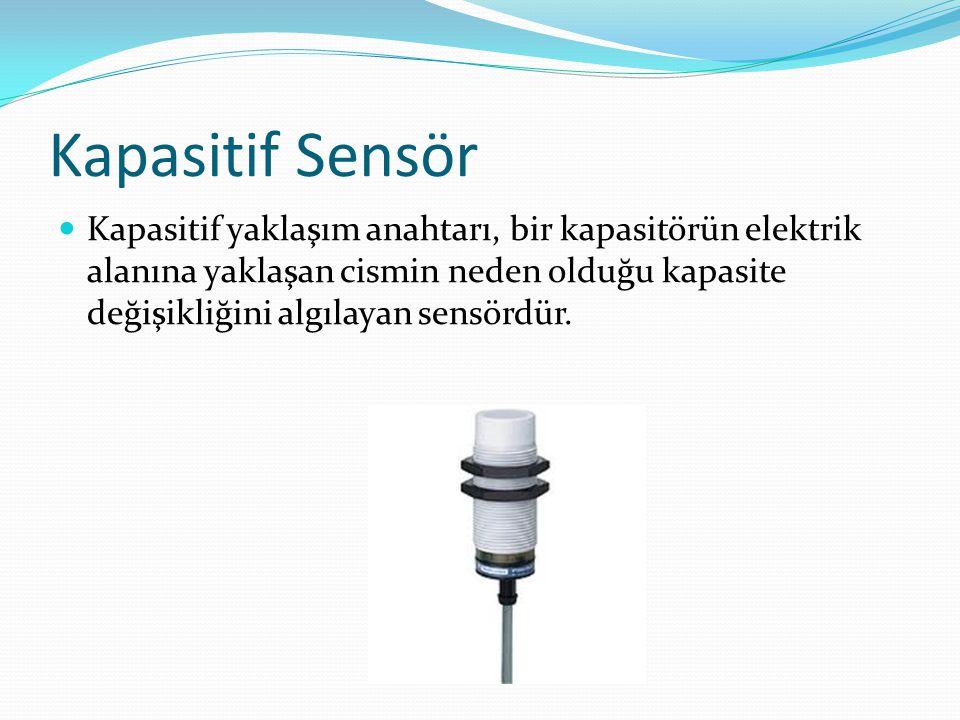 Kapasitif Sensör  Kapasitif yaklaşım anahtarı, bir kapasitörün elektrik alanına yaklaşan cismin neden olduğu kapasite değişikliğini algılayan sensörd