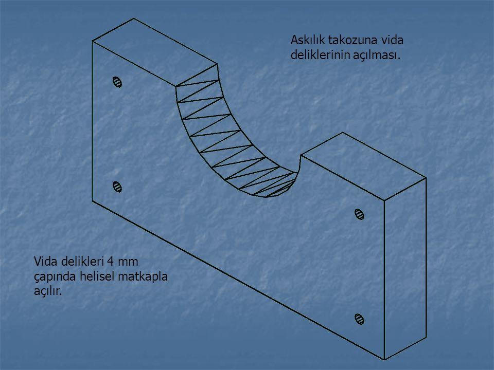 Askılık takozuna vida deliklerinin açılması. Vida delikleri 4 mm çapında helisel matkapla açılır.