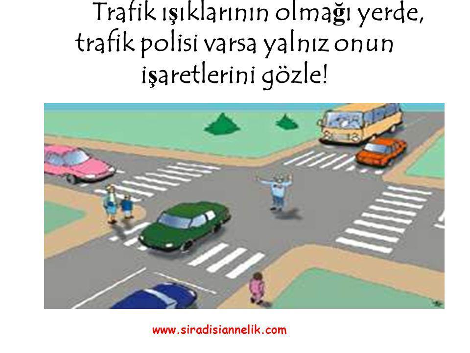 Trafik ı ş ıklarının olma ğ ı yerde, trafik polisi varsa yalnız onun i ş aretlerini gözle.