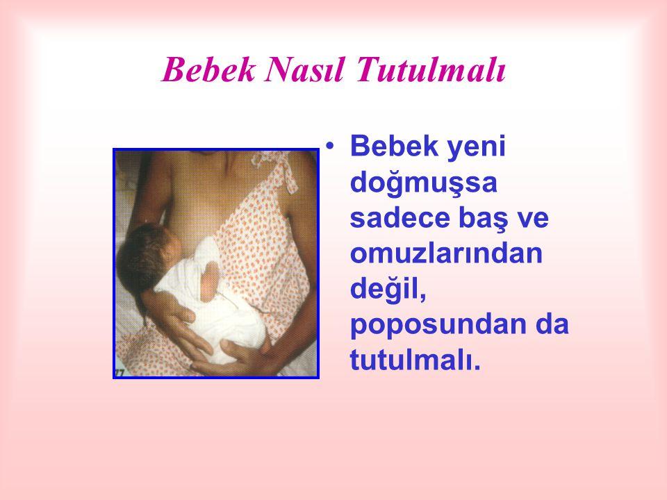 Bebek Nasıl Tutulmalı Bebek yeni doğmuşsa sadece baş ve omuzlarından değil, poposundan da tutulmalı.