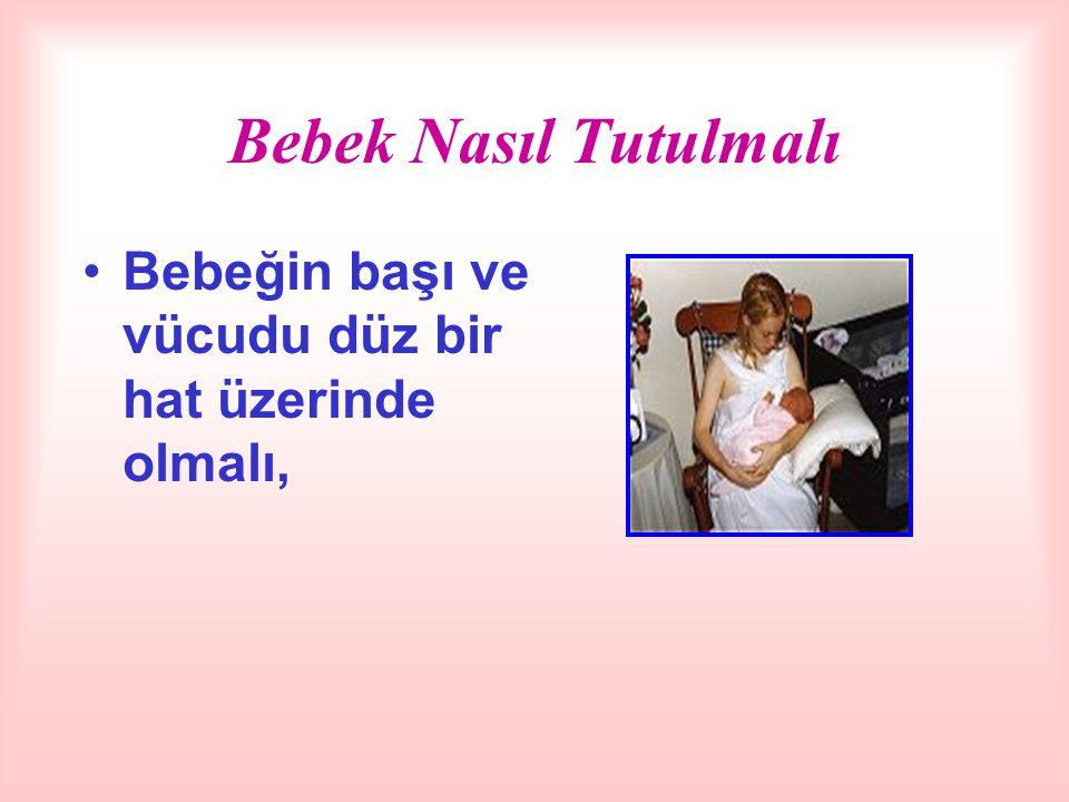 Bebek Nasıl Tutulmalı Yüzü memeye doğru, burnu meme ucunun karşısında durmalı,