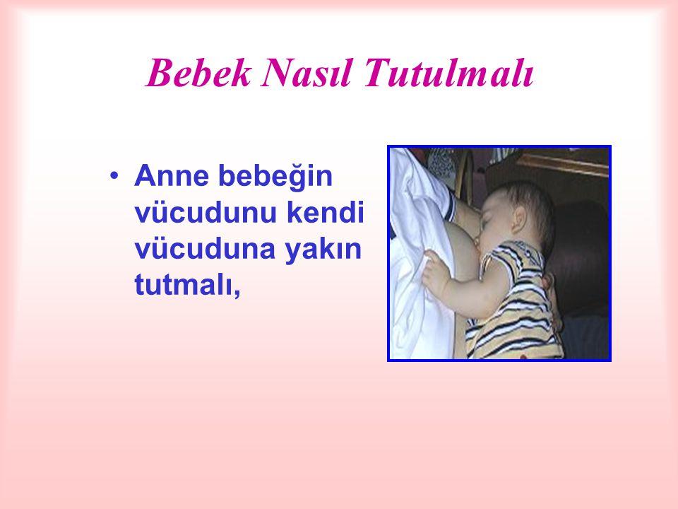 Bebeğin Diğer Kolla Tutulması - Annenin önkolu bebeğin vücudunu tutar, -Eli, bebeğin başını kulak hizasından ya da altından destekler, arka tarafına bastırılarak baş itilmez.
