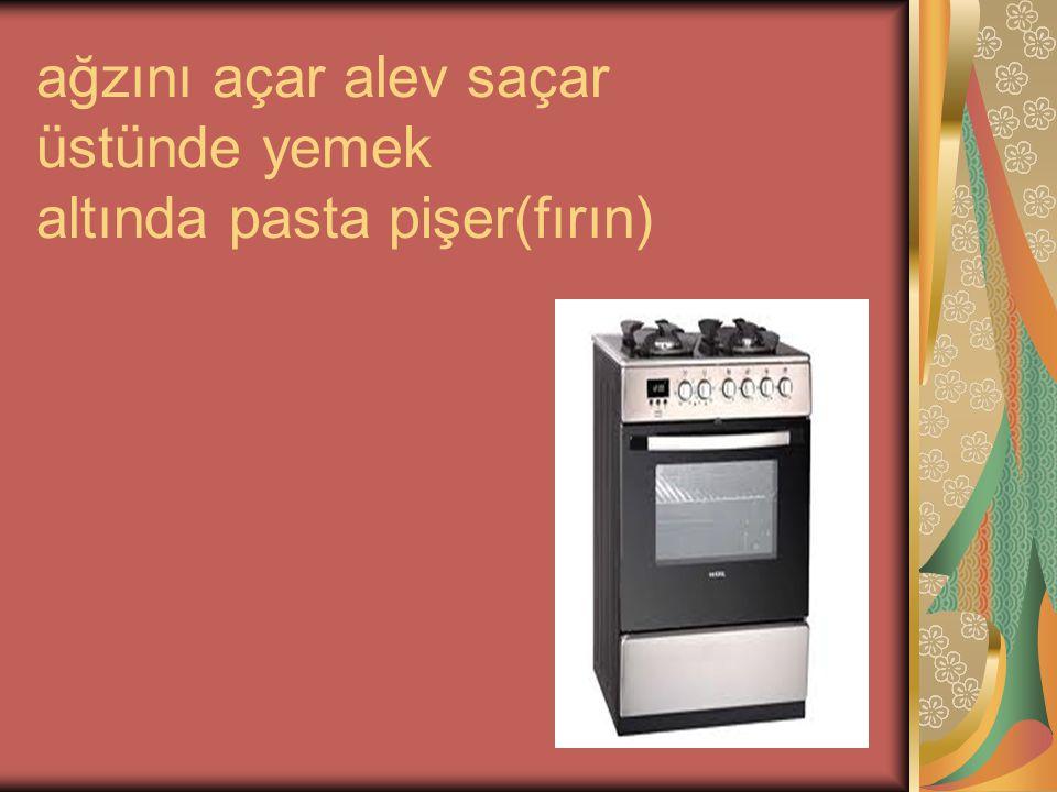 ağzını açar alev saçar üstünde yemek altında pasta pişer(fırın)