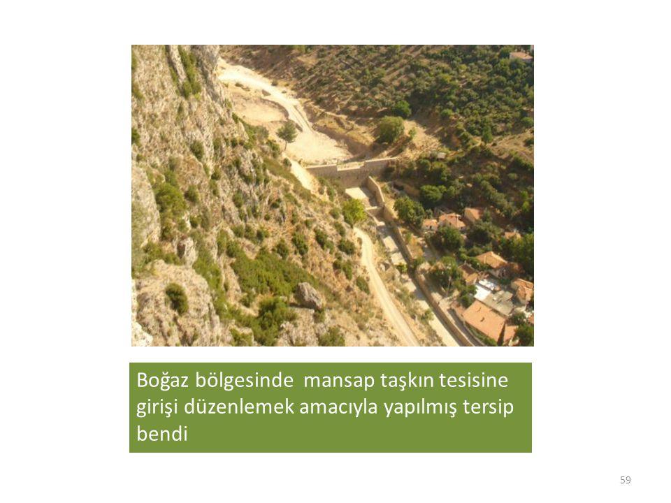 Boğaz bölgesinde mansap taşkın tesisine girişi düzenlemek amacıyla yapılmış tersip bendi 59