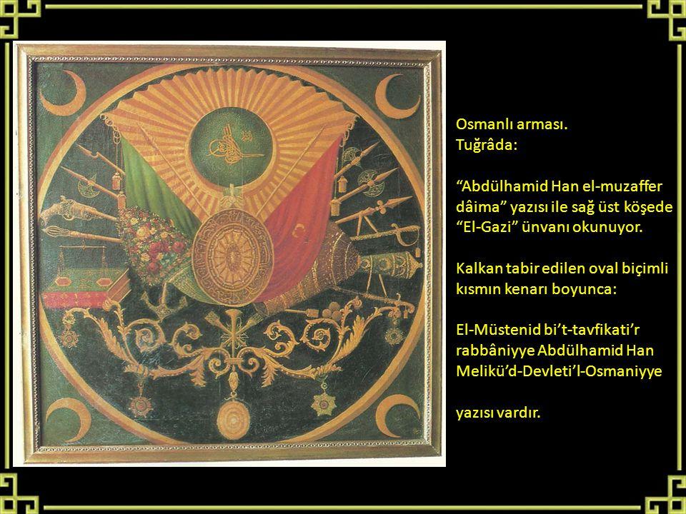 """Osmanlı arması. Tuğrâda: """"Abdülhamid Han el-muzaffer dâima"""" yazısı ile sağ üst köşede """"El-Gazi"""" ünvanı okunuyor. Kalkan tabir edilen oval biçimli kısm"""