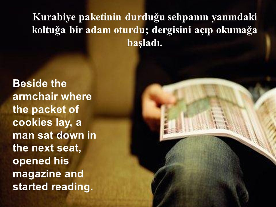 Beside the armchair where the packet of cookies lay, a man sat down in the next seat, opened his magazine and started reading.