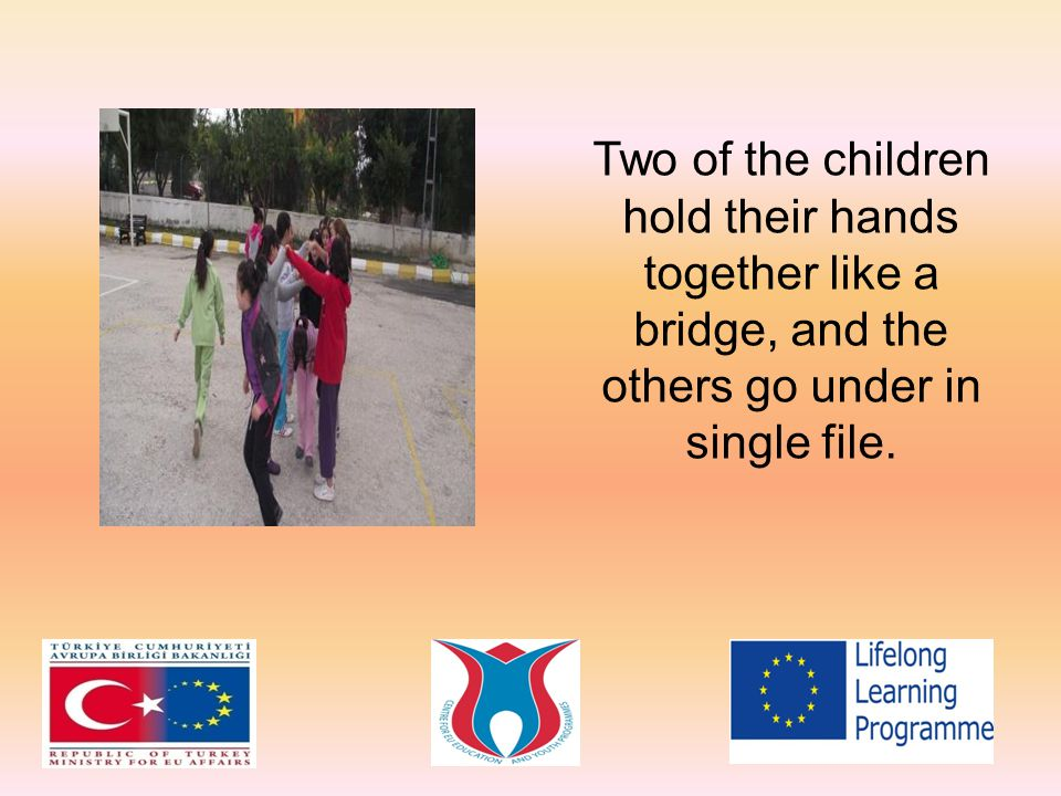 Two of the children hold their hands together like a bridge, and the others go under in single file.
